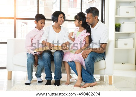 happy indian family eating pizza at home #490482694