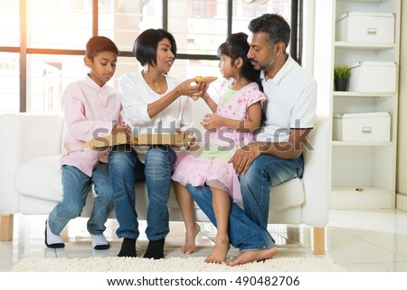 happy indian family eating pizza at home #490482706