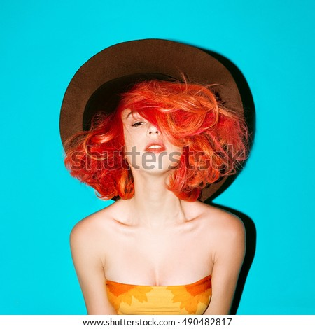 Sensual Model in Hat and bright Red hair Stylish Autumn