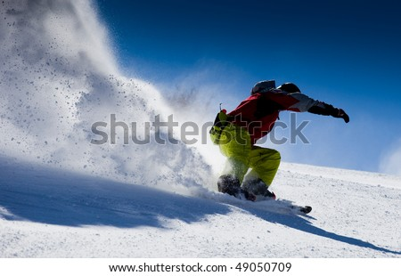 Aggressive skier making snow  powder while turning and skiing fast #49050709