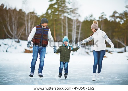Family on ice-rink