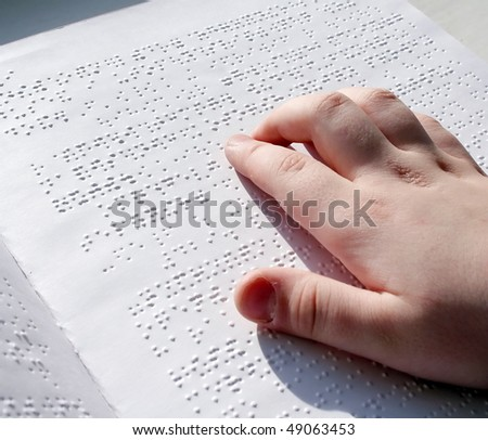 Reading books on Braille. #49063453