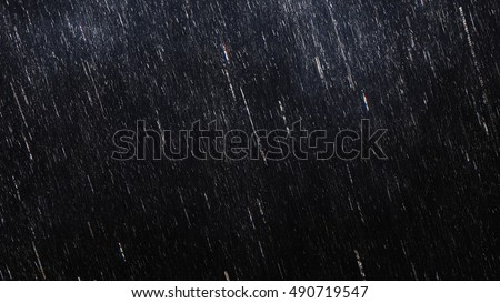 Falling raindrops footage animation in slow motion on dark black background with fog, lightened from top, rain animation with start and end, perfect for film, digital composition, projection mapping