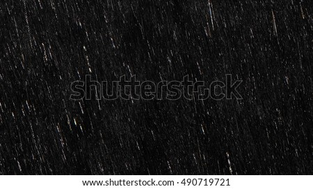 Falling raindrops footage animation in slow motion on black background, black and white luminance matte, rain animation with start and end, perfect for film, digital composition, projection mapping Royalty-Free Stock Photo #490719721