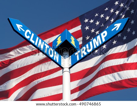 Presidential elections in the US. Names of Clinton and Trump written in a directional road signs over american flag #490746865