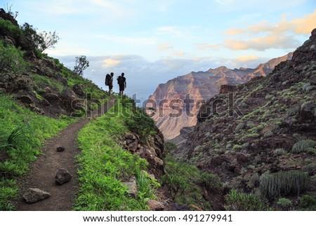 Trekking on Gran Canaria Island to Gui Gui beach. Royalty-Free Stock Photo #491279941