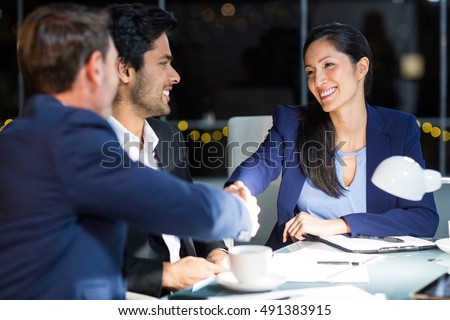 Businessman shaking hands with a colleague in the office #491383915