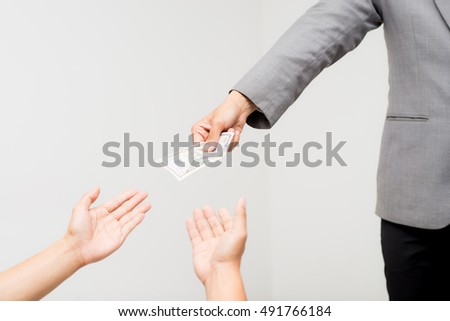 Close-up Of Person Hand Giving Money To Other Hand,Money from hand in business suit to another hand, hand to hand money pass,Man in business suit pay or give money for something, #491766184