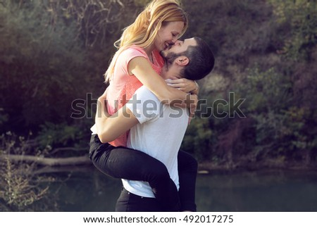 Young beautiful couple kissing in nature #492017275