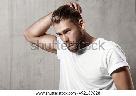 Handsome bearded man in a blank white t-shirt with stylish hair #492189628