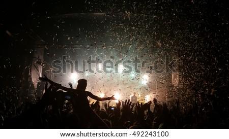 People enjoying good music - confetti falling