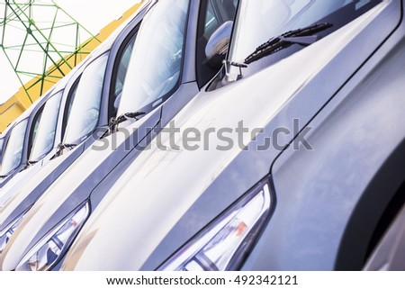 A row of new cars parked at a car dealer shop #492342121