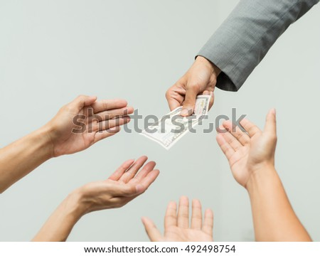 Money from hand in business suit to another hand,Man in business suit pay or give money for something,Close-up Of Person Hand Giving Money To Other Hand, hand to hand money pass #492498754