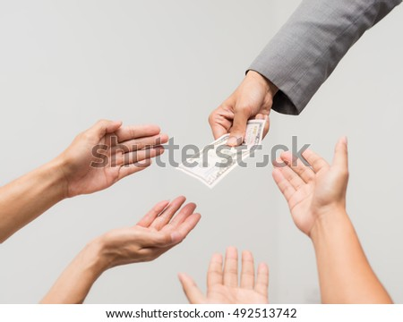 Money from hand in business suit to another hand,Man in business suit pay or give money for something,Close-up Of Person Hand Giving Money To Other Hand, hand to hand money pass #492513742