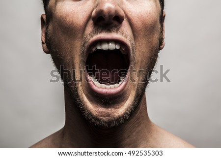 close up portrait of a man shouting, mouth wide open Royalty-Free Stock Photo #492535303