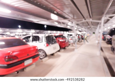 Abstract blurred car in parking background. #492538282