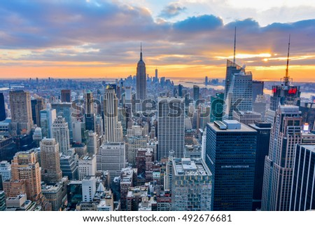 NEW YORK, UNITED STATES - DECEMBER 28, 2015 -  New York City skyline with urban skyscrapers at sunset. #492676681