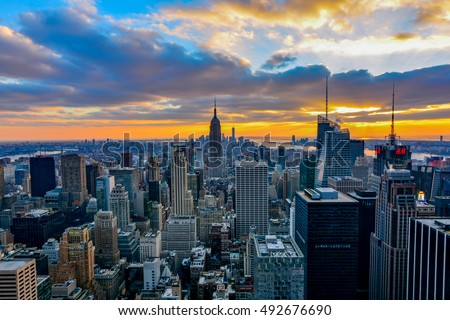 NEW YORK, UNITED STATES - DECEMBER 28, 2015 -  New York City skyline with urban skyscrapers at sunset. #492676690