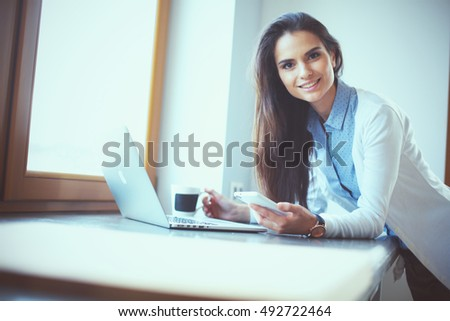 Young female standing near desk #492722464
