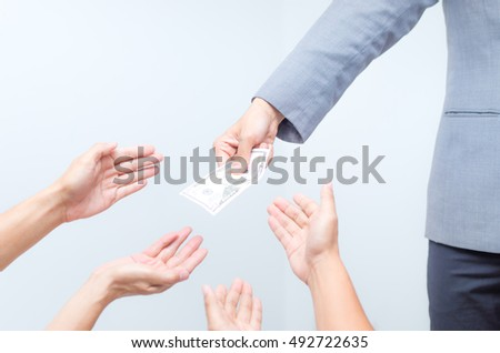Money from hand in business suit to another hand,Man in business suit pay or give money for something,Close-up Of Person Hand Giving Money To Other Hand, hand to hand money pass #492722635