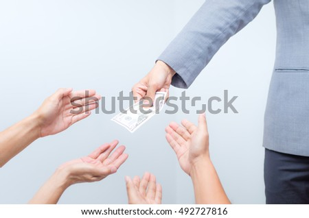 Money from hand in business suit to another hand,Man in business suit pay or give money for something,Close-up Of Person Hand Giving Money To Other Hand, hand to hand money pass #492727816