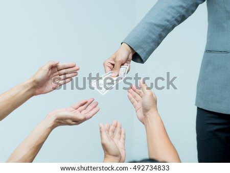 Money from hand in business suit to another hand,Man in business suit pay or give money for something,Close-up Of Person Hand Giving Money To Other Hand, hand to hand money pass #492734833