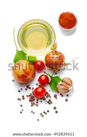 Italian food & drink healthy lifestyle concept: Mediterranean vegetables, herbs & spices. Olive oil, tomatoes, onion, garlic, parsley & peppers. Top view. Isolated on white. #492839611