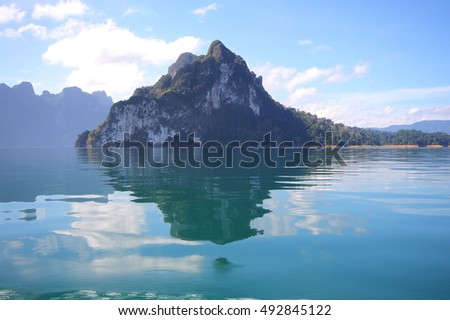 Beautiful scenery of the beautiful water reflection with clear sky at lake river in natural attractions,Ratchaprapha Dam at Khao Sok National Park,Surat Thani Province in Thailand. #492845122