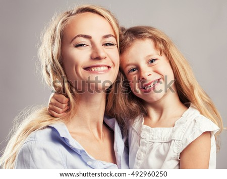 Mother with little girl. Parent with child. Happy family clouse up #492960250