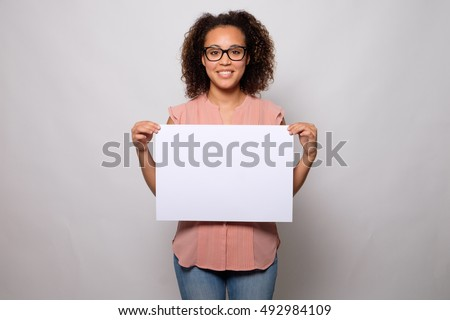 Black woman displaying white banner isolated on background #492984109