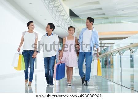 Happy Asian family enjoying shopping on weekend #493038961