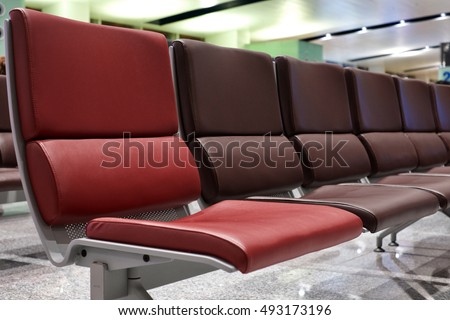 Red Chair in Brown Chair #493173196