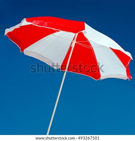 Red and white umbrella #493267501