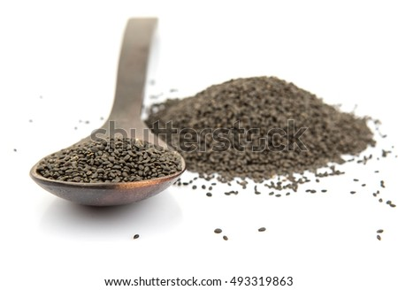 Basil seeds in wooden spoon over white background #493319863