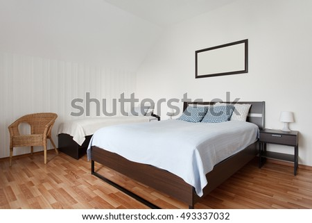 Small bright bedroom with two bunk beds. Interior design