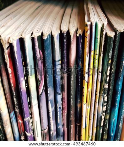 Comic books standing close Royalty-Free Stock Photo #493467460