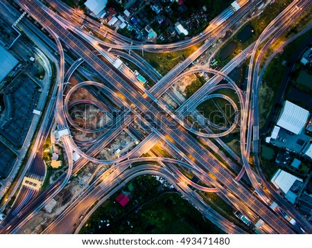 Aerial View Above of Busy Highway Road Junctions at Night. The Intersecting Freeway Road Overpass The Eastern Outer Ring Road of Bangkok. Royalty-Free Stock Photo #493471480