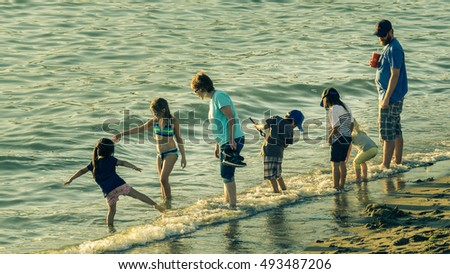 Vancouver Canada,July 2016,family fun at English bay beach Vancouver Canada #493487206