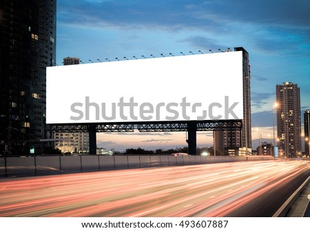 Blank template  for outdoor advertising or blank billboard on the highway during the twilight. With clipping path on screen - can be used for trade shows, and advertising or promotional poster.