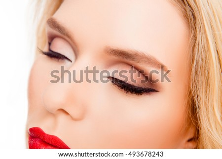 Close up of young woman with professional make up on eyes #493678243