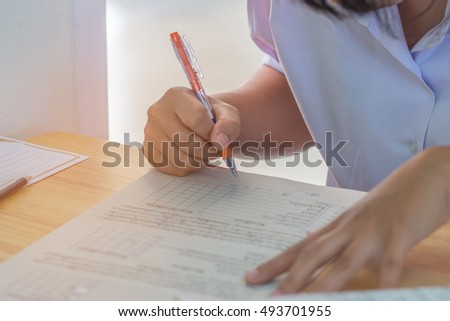 Blurred of student testing in exercise, exams answer sheets or test paper with pen, : education concept #493701955