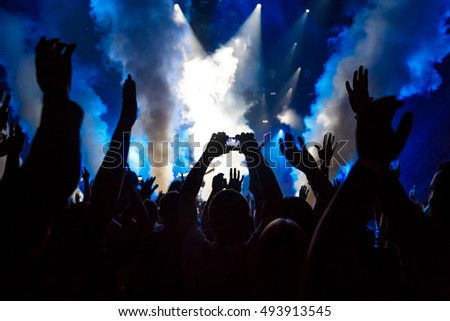 Take photo by smartphone in front of concert stage, during the light show #493913545