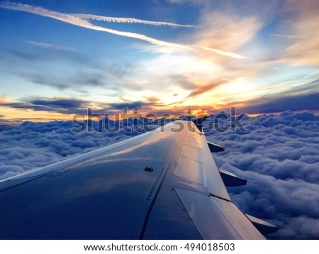 Sunset sky, Airplane wing in flight  view from window seat #494018503