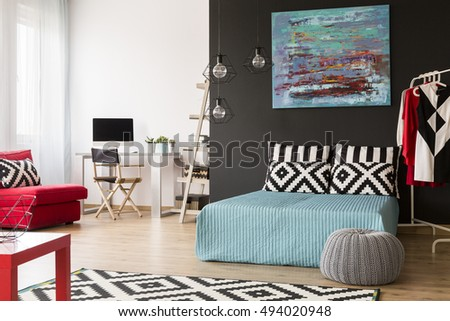 Spacious black and white flat in a new style with large bed and small office area #494020948