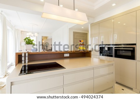 Modern house and spacious open plan kitchen in beige #494024374