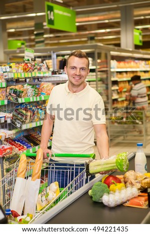 Portrait of smiling man buy products in a supermarket #494221435