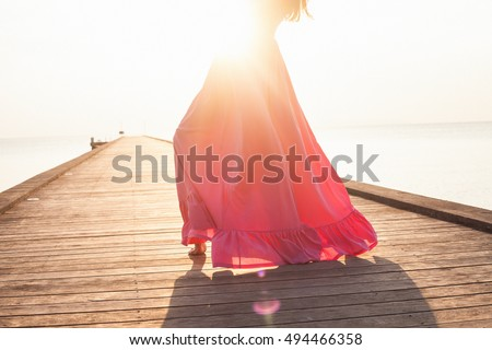 Beauty summer fashion model girl wear fashion outfit,sunny holidays.Sunny yellow background. Beautiful woman with long pink dress,fashion details,sunset background,summer concept image.sensual woman #494466358