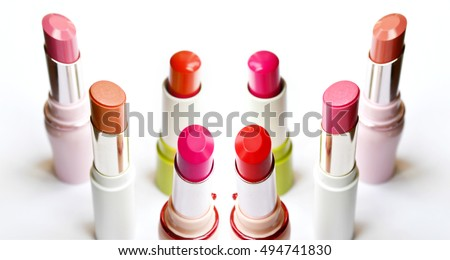 Set of pink and red lipsticks isolated on white #494741830