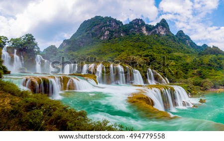 Ban Gioc waterfall in Cao Bang, Viet Nam - The waterfalls are located in an area of mature karst formations were the original limestone bedrock layers are being eroded Royalty-Free Stock Photo #494779558