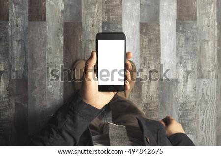 Businessman holding phone #494842675